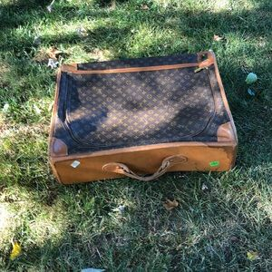 Well Traveled Vintage Louis Vuitton suitcase